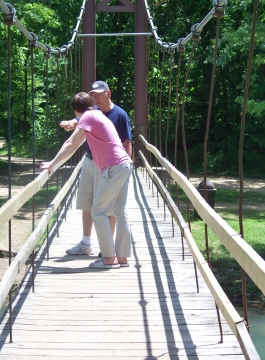 Our grandson, Harrison, stops for a chat with his Grandpa, on the foot bridge.