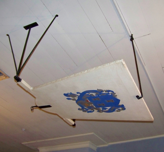 "This fan, over the dining room table, would be operated by a slave. It was often called a ""shoo-fly"" fan."