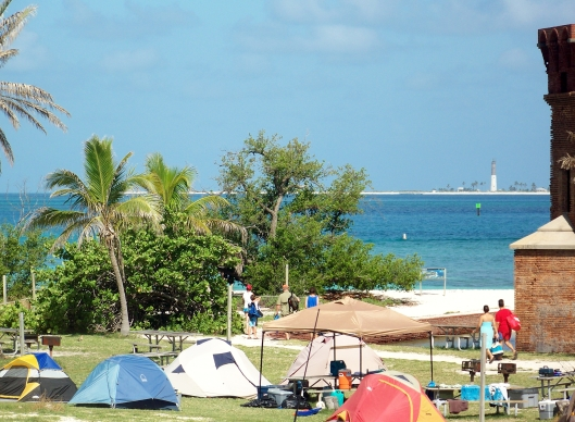 Campers set up at Fort Jefferson. You can see Loggerhead Key and its lighthouse in the background.