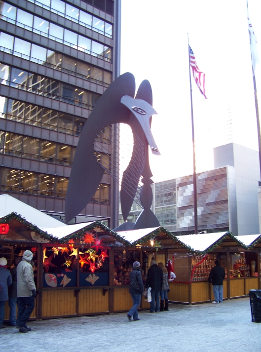 Here you see the booths of Christkindlmarket in front of the Chicago Picasso at Daley Plaza.