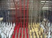 All of these yarns are fed into the weaving loom to create a finished woolen product.