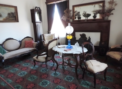 This room served as the formal parlor, where guests were received. Fortunately, the home has many of the furnishings that were used by the Watkins family in the 19th century.