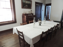 This is the dining room with its large table that could accommodate the many people who lived in the home and who visited the home.