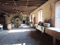 In this large room, your guide will give you some history on Waltus Watkins and his woolen mill. In the background, you can see a rotary fulling machine, used to wash and thicken the wool.