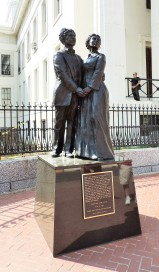 A statue of Dred Scott and his wife. Harriet, stands on the Courthouse grounds.
