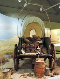 A wagon set up to depict the long trip on the Oregon Trail. How important it must have been for a child to have that one doll to remind her that while life was changing, some things would never change.