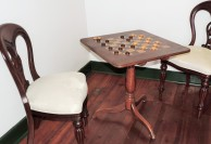 A friendly game of checkers is set up in one of the rooms.