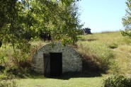 This small springhouse down the hill from the house was where the Ray's would get water. It also served their needs for refrigeration.
