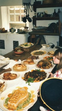 A spread of food items at Colonial Williamsburg. You can see our granddaughter eyeing them, wishing she might just have some.