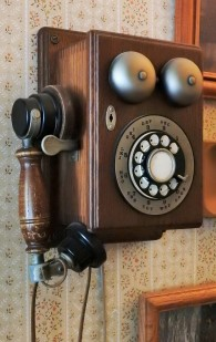 This is our version of an old telephone for this old house. When our grandchildren come, they still plug it in. are amazed by the dial, and use it to talk to others near and far.